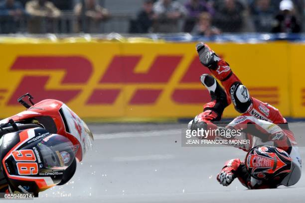 TOPSHOT Japan's rider Kaito Toba falls off his Honda Team Asia N°27 during a crash with Italy's rider Manuel Pagliani during a Moto3 qualifying...