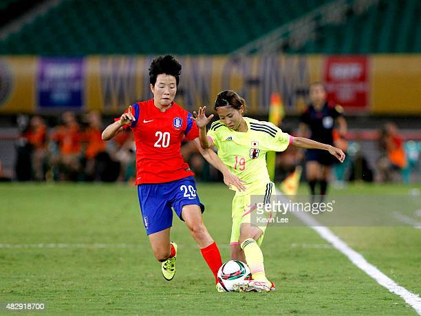 Japan's Rie Azami and Korea Republic's Kim Hyeri compete for the ball during EAFF Women's East Asian Cup 2015 final round at Wuhan Sports Center...