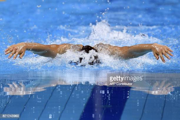 TOPSHOT Japan's Rikako Ikee competes in a women's 100m butterfly semifinal during the swimming competition at the 2017 FINA World Championships in...