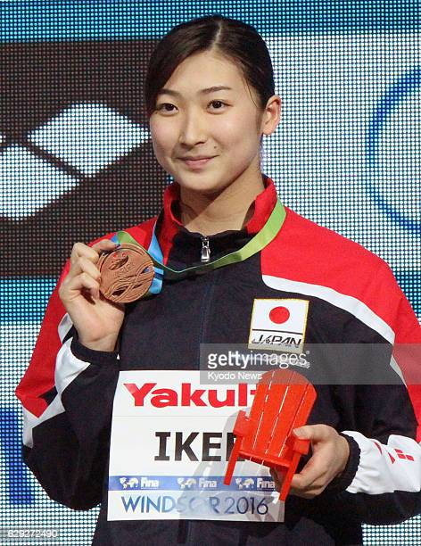 Japan's Rikako Ikee holds the bronze medal she won in the women's 100meter butterfly at the world shortcourse swimming championships in Windsor...