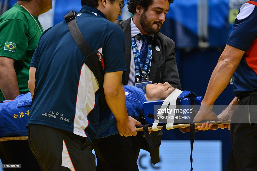 Japan's Riki Nakaya is carried on a stretcher after loosing the fight against Mongolia's Nyam-Ochir Sainjargal in the Men's 73kg category of the IJF World Judo Championship in Rio de Janeiro, Brazil, on August 28, 2013.