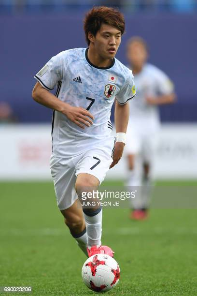 Japan's Ritsu Doan dribbles the ball during their U20 World Cup round of 16 football match between Venezuela and Japan in Daejeon on May 30 2017 /...