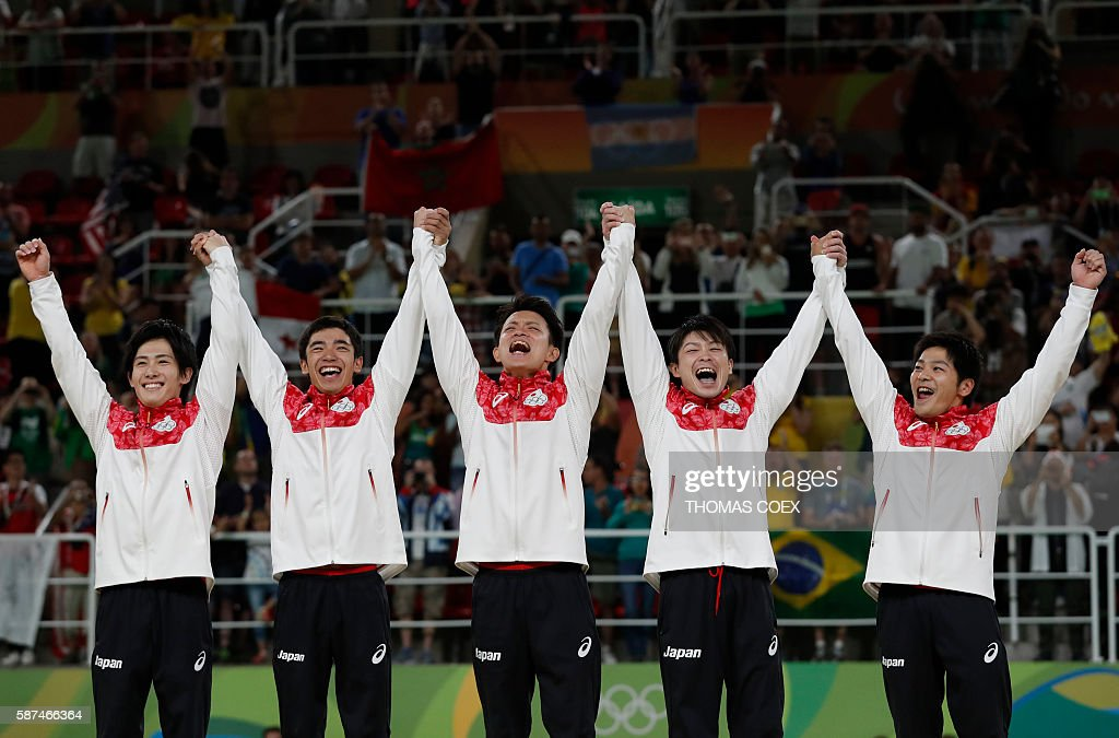 Japan's Ryohei Kato Japan's Kenzo Shirai Japan's Yusuke Tanaka Japan's Kohei Uchimura and Japan's Koji Yamamuro celebrate on the podium after winning...