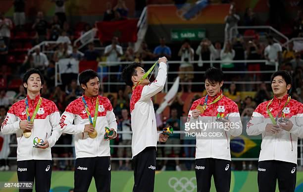 Japan's Ryohei Kato Japan's Kenzo Shirai Japan's Yusuke Tanaka Japan's Kohei Uchimura and Japan's Koji Yamamuro pose with their gold medals on the...