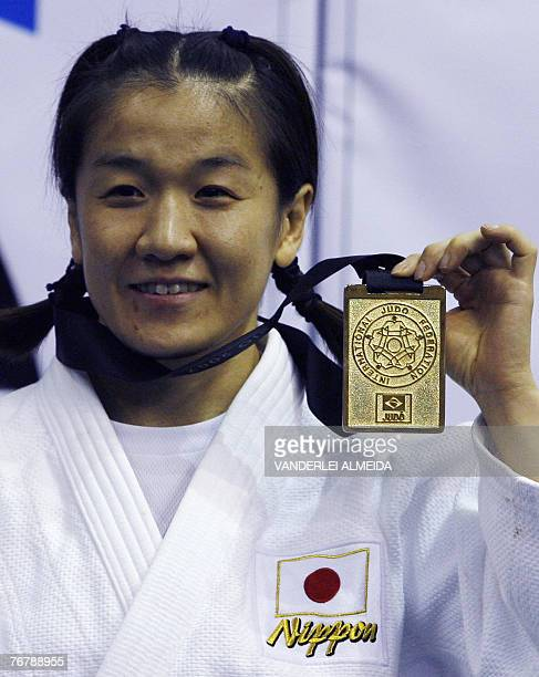 Japan's Ryoko Tani celebrates on the podium after the women's 48kg category final at the 25th World Judo Championship in Rio de Janeiro 16 September...
