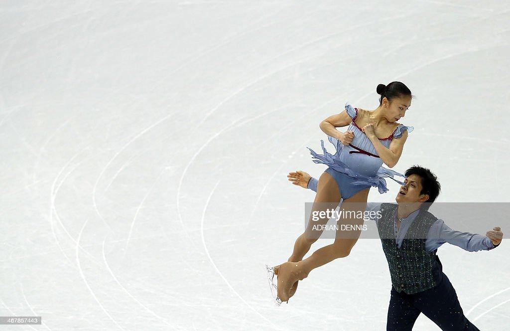 Japan's Ryuichi Kihara and Japan's Narumi Takahashi perform in the Figure Skating Pairs Team Free Program at the Iceberg Skating Palace during the...