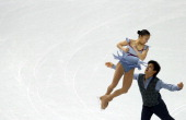 Japan's Ryuichi Kihara and Japan's Narumi Takahashi perform in the Figure Skating Pairs Team Free Program at the Iceberg Skating Palace during the...