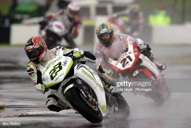 Japan's Ryuichi Kiyonari takes the Esses followed by Australia's Troy Bayliss during race two of the SBK World Superbikes at Donington Park Castle...