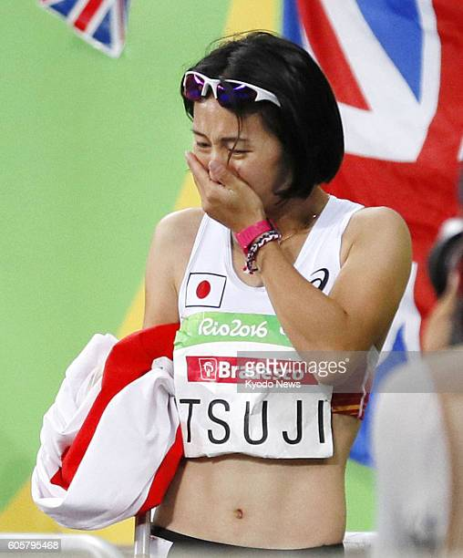 Japan's Sae Tsuji celebrates after winning bronze in the women's 400meter T4547 class for athletes with single or double full or partial arm...