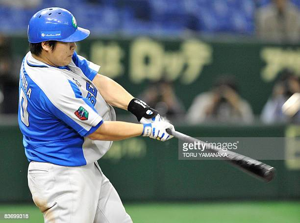 Japan's Saitama Seibu Lions slugger Takeya Nakamura hits the ball to a threerun homer during the second inning of the Asia Series 2008 baseball game...