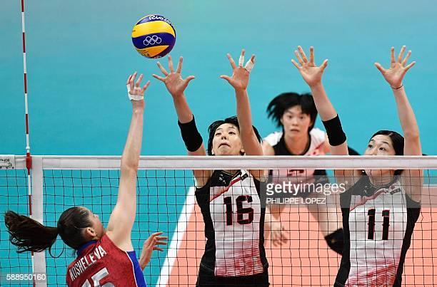 Japan's Saori Sakoda and Erika Araki jump to block the ball during the women's qualifying volleyball match between Russia and Japan at the...