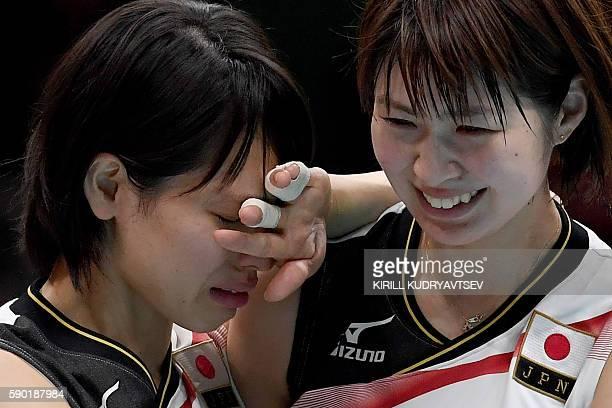 Japan's Saori Sakoda and Saori Kimura react after losing the women's quarterfinal volleyball match between Japan and USA at the Maracanazinho stadium...