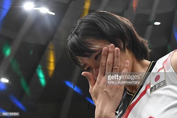 Japan's Saori Sakoda reacts after losing the women's quarterfinal volleyball match between Japan and USA at the Maracanazinho stadium in Rio de...