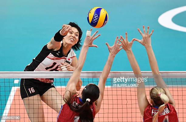 Japan's Saori Sakoda spikes the ball during the women's qualifying volleyball match between Russia and Japan at the Maracanazinho stadium in Rio de...