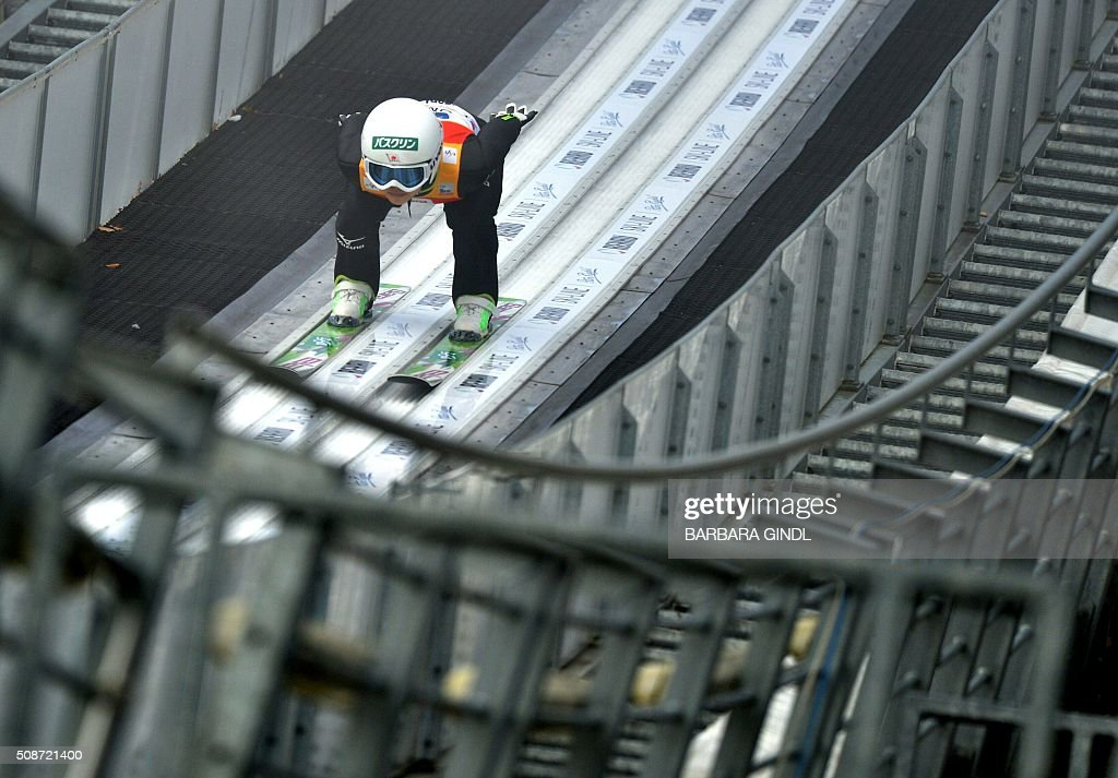 Japan's Sara Takanashi jumps during the qualifying round of the women's ski jumping world cup in Hinzenbach, Upper Austria on February 6, 2016. / AFP / APA / BARBARA GINDL / Austria OUT