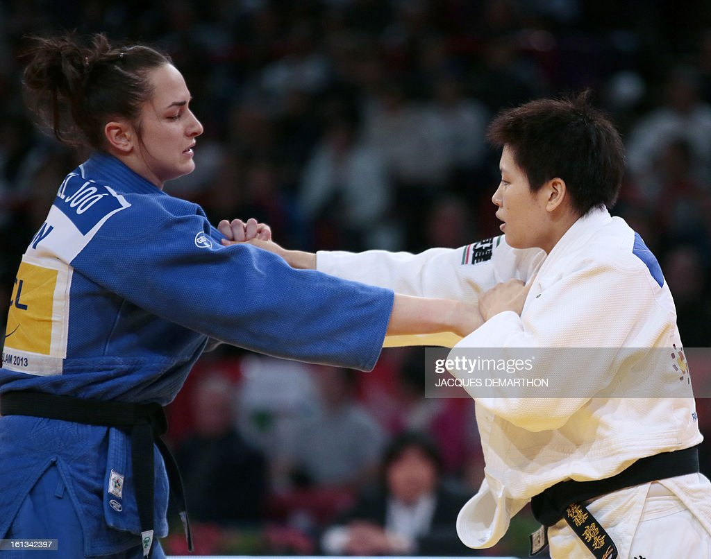 Japan's Sato Ruika (white) fights against Hungary's Abigel Joo (blue) on February 10, 2013 in Paris, during the Eliminatories of the Women -78kg of the Paris Judo Grand Slam tournament.