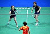 Japan's Satoko Suetsun and Miyuki Maeda return to China's Wang Xiaoli and Yu Yang during the All England Open Badminton Championships women's doubles...