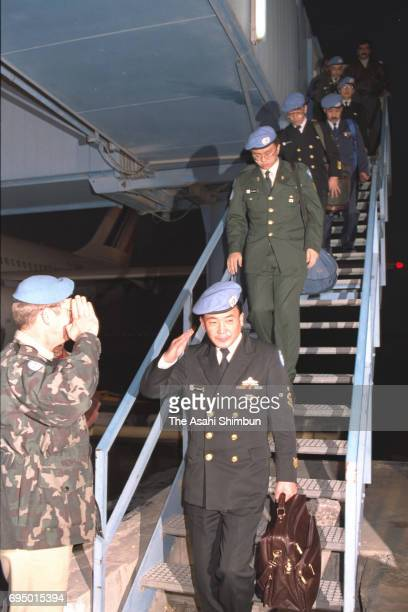 Japan's SelfDefense Force members deploying at the United Nations Disengagement Observer Force at Golan Heights arrive at Damascus Airport on...