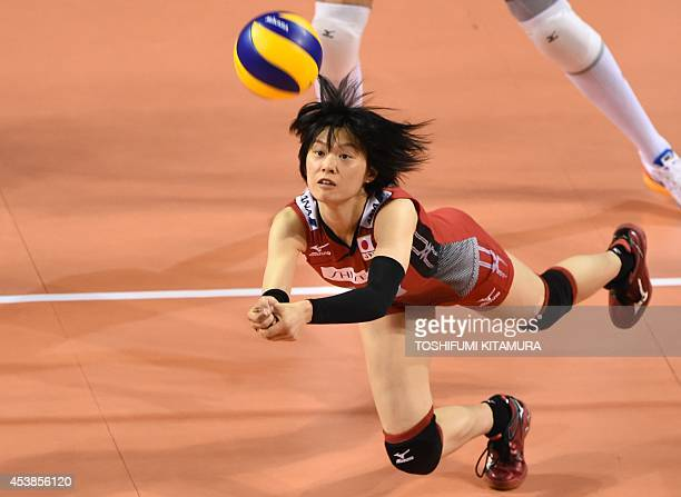 Japan's setter Haruka Miyashita dives to save the ball during their women's volleyball World Grand Prix final round first day match against Russia in...