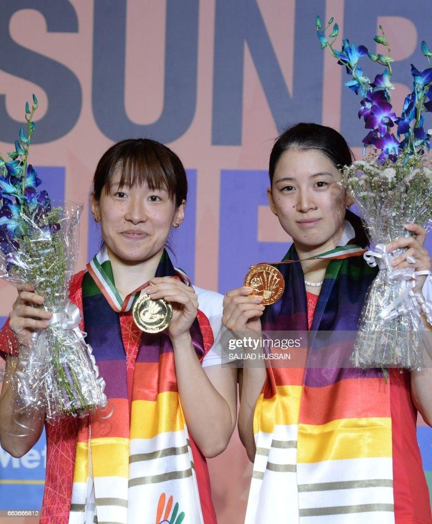 Japan s Shiho Tanaka L and Koharu Yonemoto R pose for pictures