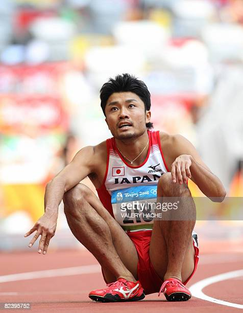 Japan's Shingo Suetsugu looks at the result monitor after competing in the men's first round 200m heat 7 at the 'Bird's Nest' National Stadium during...