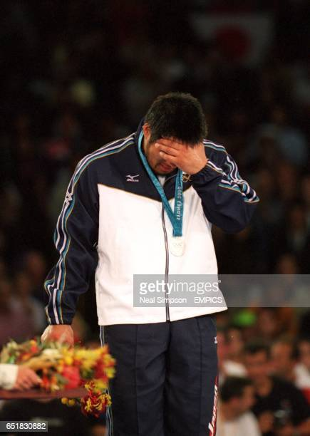 Japan's Shinichi Shinohara is overcome with emotion after winning the silver medal in the Men's 100kg category