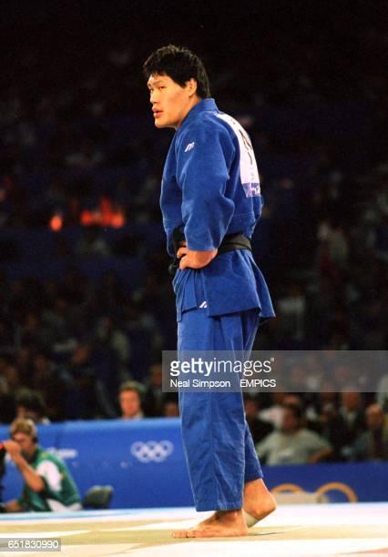 Japan's Shinichi Shinohara looks unhappy following his defeat