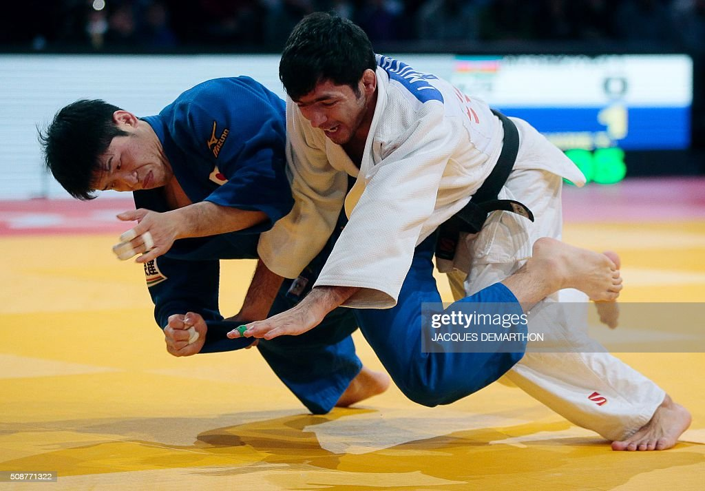 Japan's Shishime Toru (L) comeptes and wins against Azerbaijan's Ilgar Mushkiyev (R) in the men's under 60 kg final of the Paris Grand Slam Judo tournament on February 6, 2016 in Paris. / AFP / JACQUES DEMARTHON