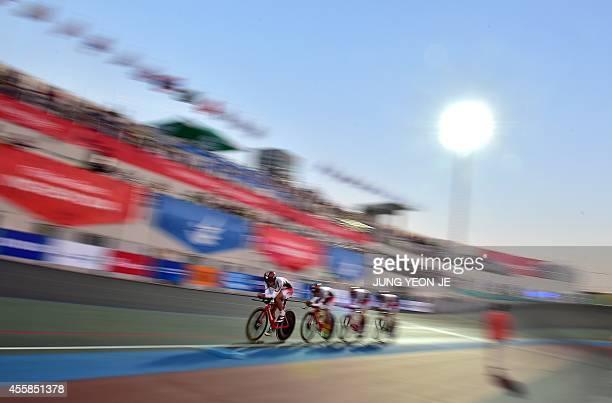 Japan's Shogo Ichimaru Kazushige Kuboki Eiya Hashimoto and Ryo Chikatani compete in the men's team pursuit cycling track final event during the 2014...