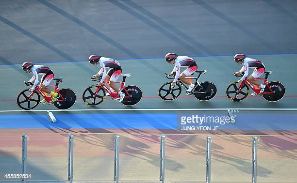 Japan's Shogo Ichimaru Kazushige Kuboki Eiya Hashimoto and Ryo Chikatani compete in the men's team pursuit cycling track first round event during the...