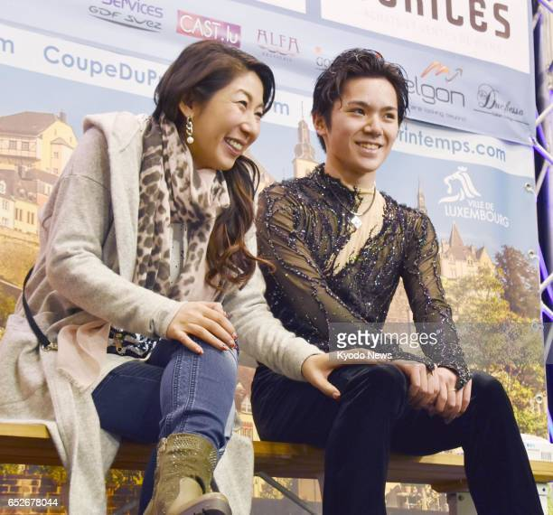 Japan's Shoma Uno and his coach Mihoko Higuchi are seen at the kiss and cry after Uno completed his free program at the Coupe du Printemps figure...