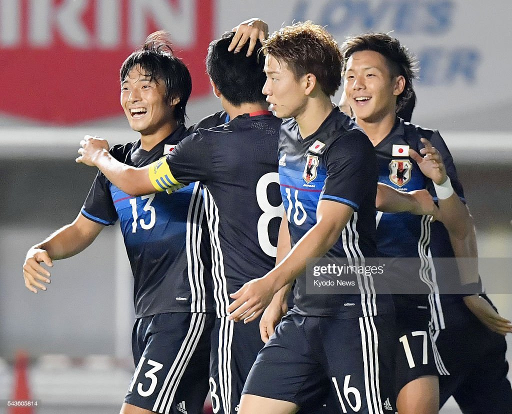 Japan's Shoya Nakajima (13) celebrates with teammates after scoring an equalizer during the first half of an Under-23 friendly against South Africa in the central Japan city of Matsumoto on June 29, 2016.
