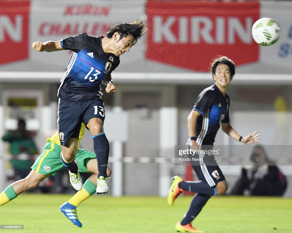 Japan's Shoya Nakajima (13) scores the team's third goal on a header during the first half of an Under-23 friendly against South Africa in the central Japan city of Matsumoto on June 29, 2016.