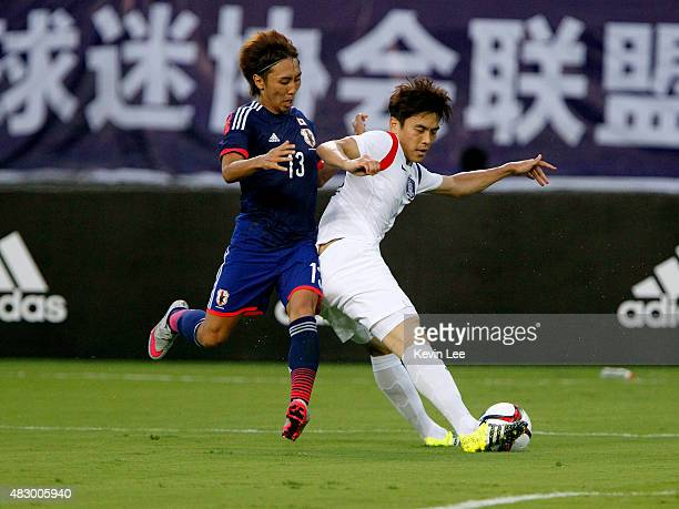 Japan's Shu Kurata competes for the ball against Korea Repubic's Kim Keehee during EAFF East Asian Cup 2015 final round in Wuhan Sports Center...