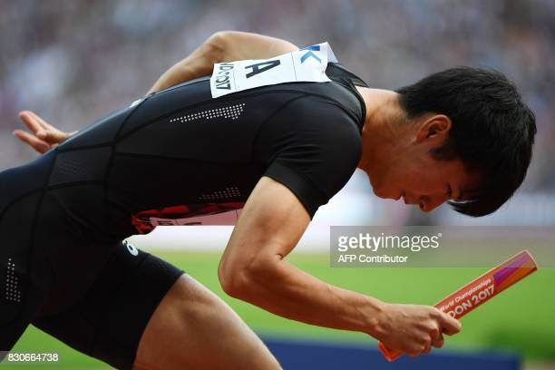 Japan's Shuhei Tada prepares to run the first leg for his team in their heat of the men's 4x100m relay athletics event at the 2017 IAAF World...