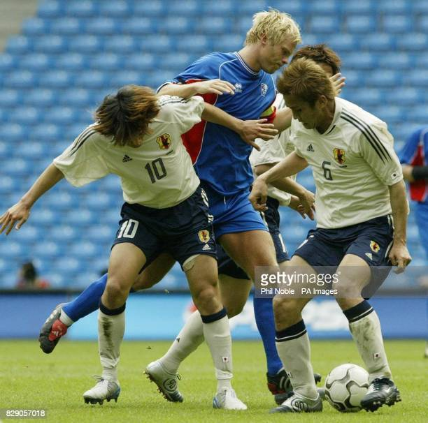 Japan's Shumsuke Nakamura and Junichi Inamoto challenges Eidur Gudjohnsen of Iceland for the ball during the opening match in the FA Summer...
