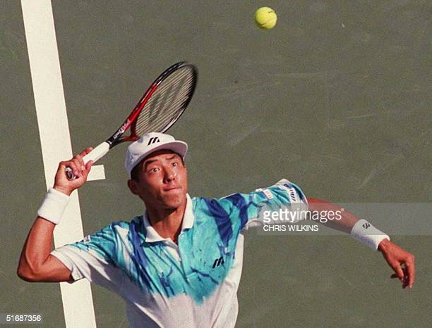 Japan's Shuzo Matsuoka serves to Petr Korda of the Czech Republic 28 August at the US Open in Flushing Meadow Today starts the first round of the...