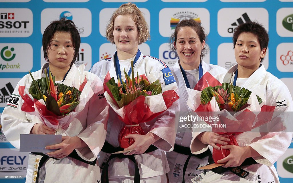 Japan's silver medalist Ogata Akari, France's gold medalist Lucie Louette, Canada's bronze medalist Catherine Roberge and Japan's bronze medalist Sato Ruika pose on the podium on February 10, 2013 after the Women -78kg category final of the Paris International Judo tournament, part of the Grand Slam, at the Palais Omnisports de Paris-Bercy (POPB) in Paris.