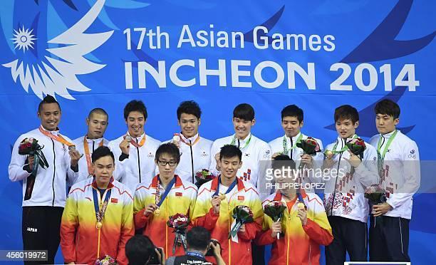 Japan's silver medallists Shinri Shioura Rammaru Harada Takuro Fujii and Katsumi Nakamura and South Korea's bronze medallists Kim Sungkyum Yang...