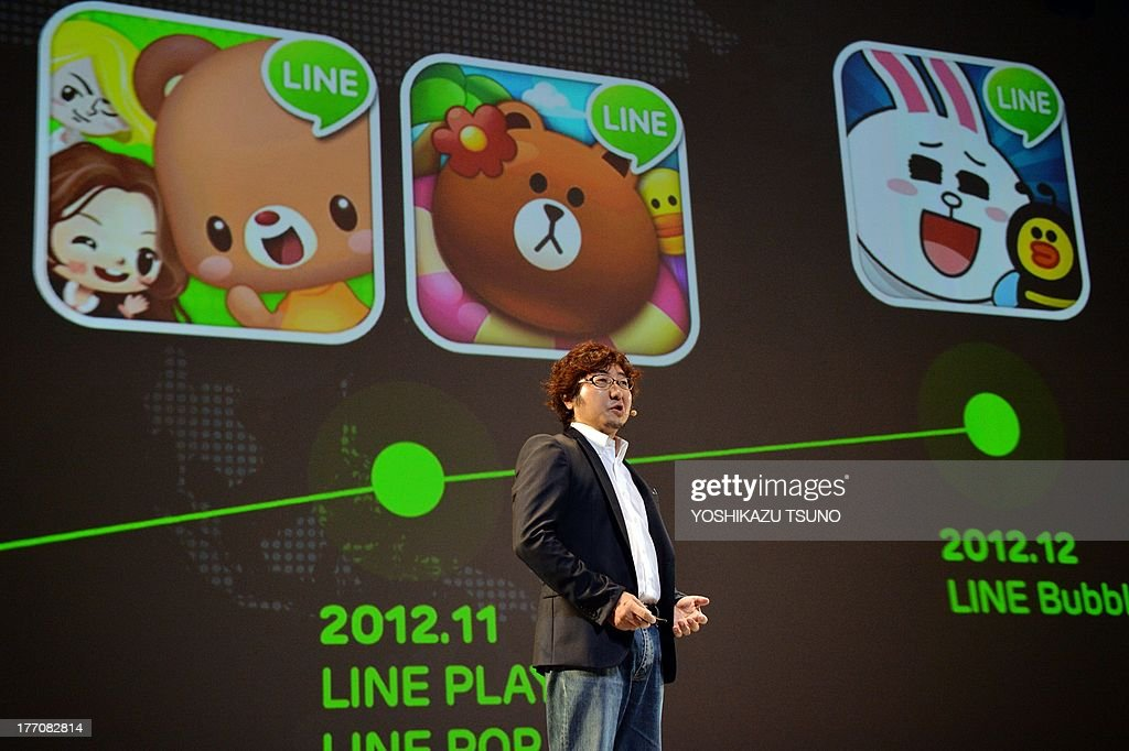 Japan's smartphone based social networking service (SNS) 'Line' president Akira Morikawa delivers a speech about Line's global strategy in Urayasu, suburban Tokyo on August 21, 2013. The Line, which has 230 million users in the world, offers users a free messages, voice calls and group chats service, and will soon start an online shopping service. AFP PHOTO / Yoshikazu TSUNO
