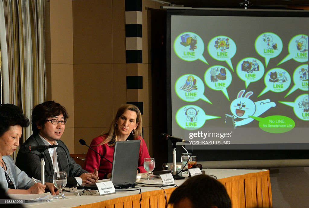 Japan's smartphone based social networking service (SNS) Line president Akira Morikawa (2nd L) speaks about Line's global strategy before the press in Tokyo on May 9, 2013. The Line, which has 150 million users in the world, offers users a free chatting and calling service, and its sales climbed 92 percent to 59.4 million USD in the first quarter in this year. AFP PHOTO / Yoshikazu TSUNO