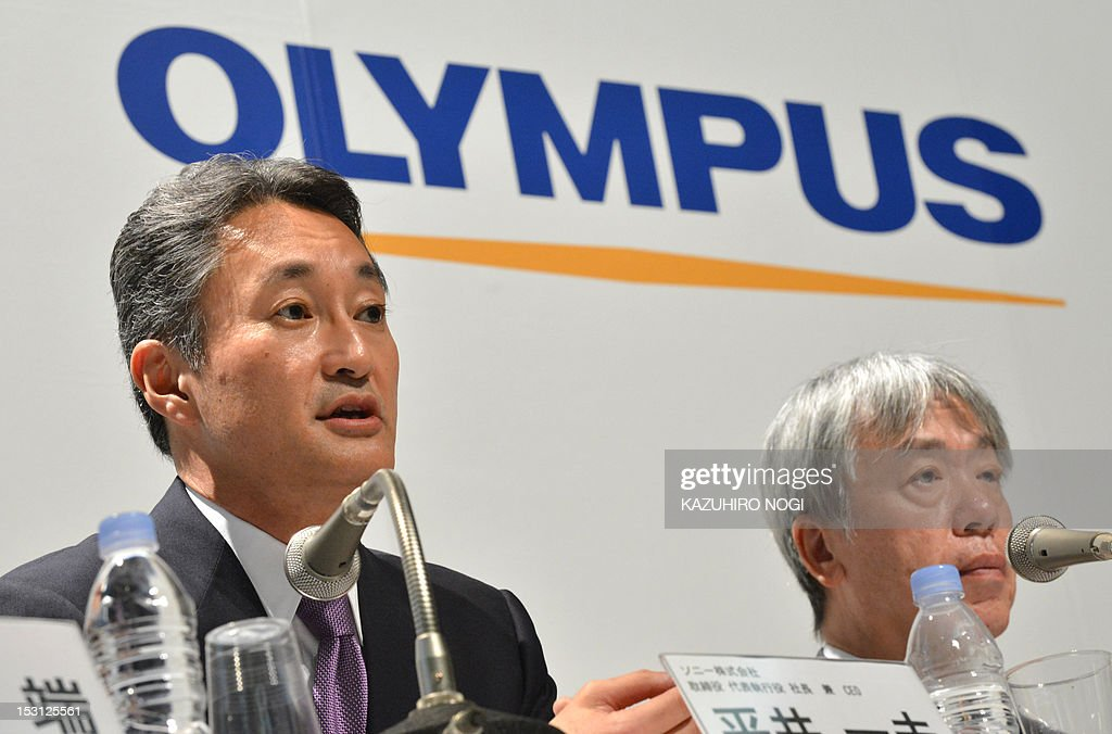 Japan's Sony Corporation President Kazuo Hirai (L) and Olympus Corporation President Hiroyuki Sasa (R) hold their joint press conference in Tokyo on October 1, 2012. Olympus and Sony announced that the two companies have entered into a business alliance agreement and a capital alliance agreement through a third-party allotment of Olympus's common shares to Sony.