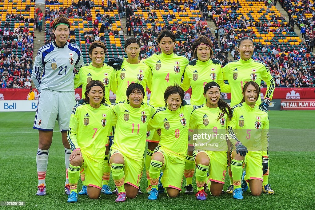 Japan's starting eleven pose for a photo prior to a match against Canada at Commonwealth Stadium on October 25, 2014 in Edmonton, Alberta, Canada.