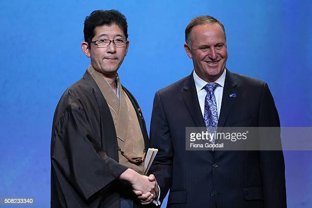 Japan's State Minister of Cabinet Office Shuichi Takatori with New Zealand Prime Minister John Key after signing the Trans Pacific Partnership at Sky...