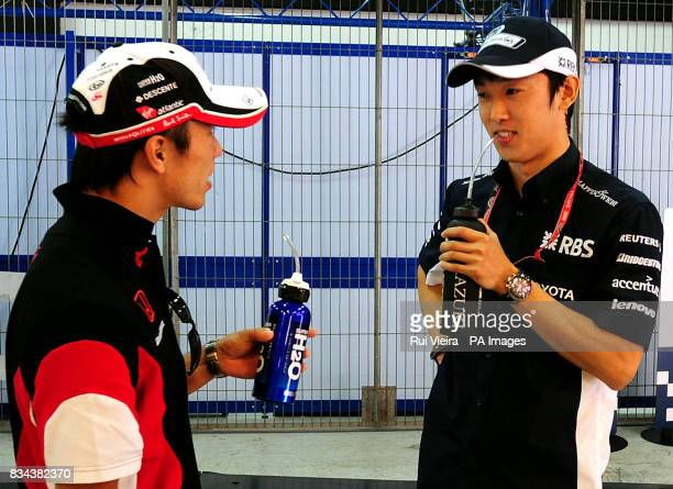 Japan's Super Aguri driver Takuma Sato and Williams driver Kazuki Nakajima before the Formula One Spanish Grand Prix