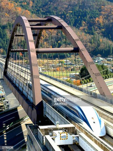 Japan's superfast Maglev train marks the new world speed record of 581 km/h on an experimental track in Tsuru city Yamanashi prefecture 100km west of...