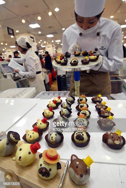 Japan's sweet shop Goncharoff chocolatier puts the finishing touches to animalshaped chocolates at Takashimaya department store's Valentine's Day...