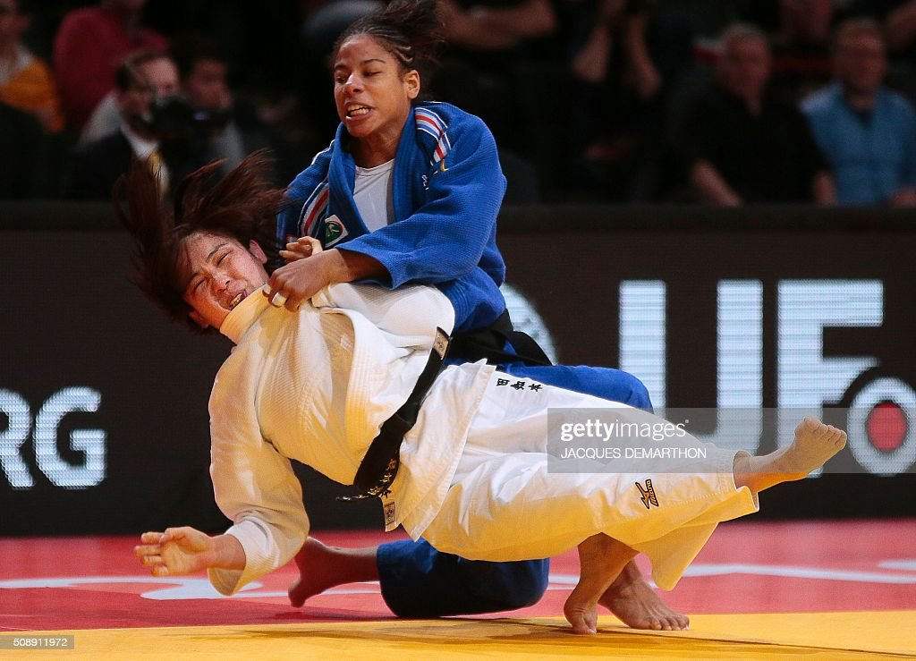 Japan's Tachimoto Haruka (L) competes against France's Fanny Estelle Posvite during the women's under 70 kg semi-final at the Paris Grand Slam Judo tournament in Paris on February 7, 2016. / AFP / JACQUES DEMARTHON