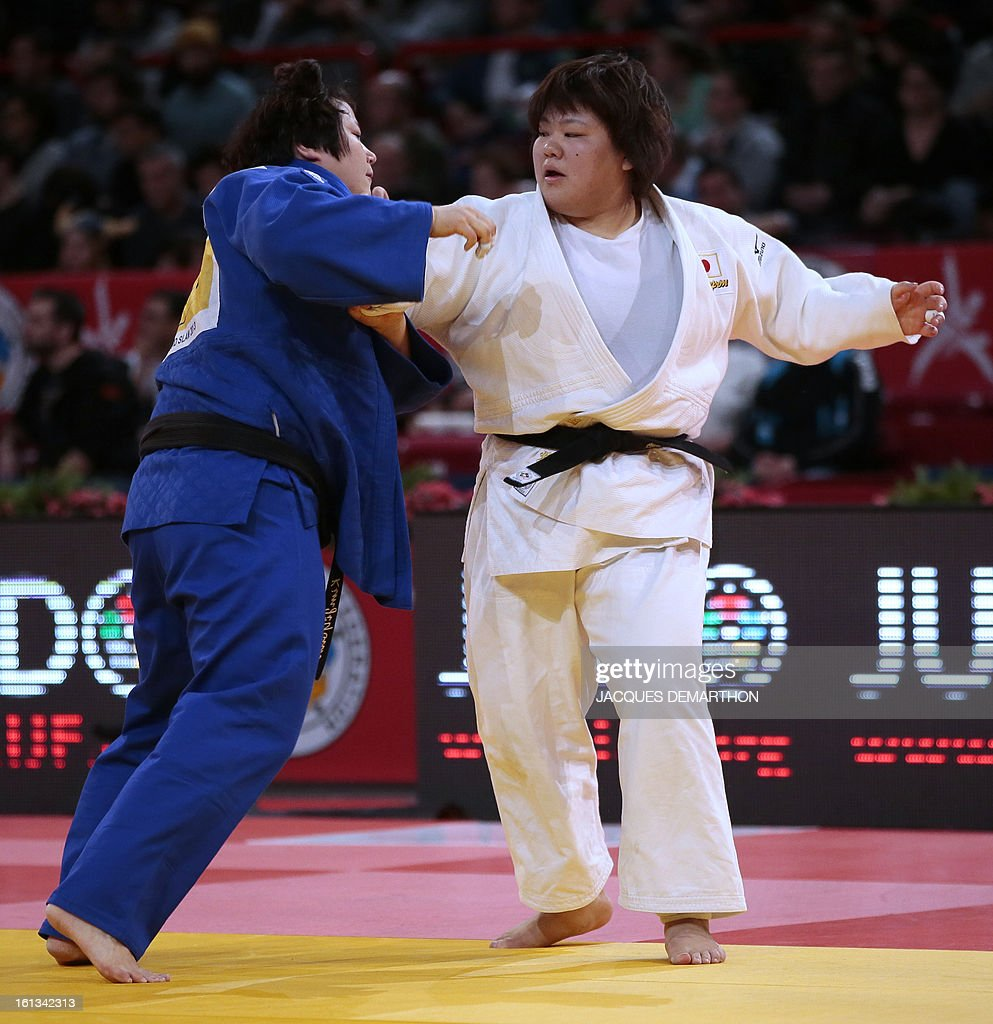 Japan's Tachimoto Megumi (R) competes against Korea's Kim Jiyounon on February 10, 2013 in the women's over 78kg category qualifying fight during the Paris International Judo tournament, part of the Grand Slam, at the Palais Omnisports de Paris-Bercy (POPB).