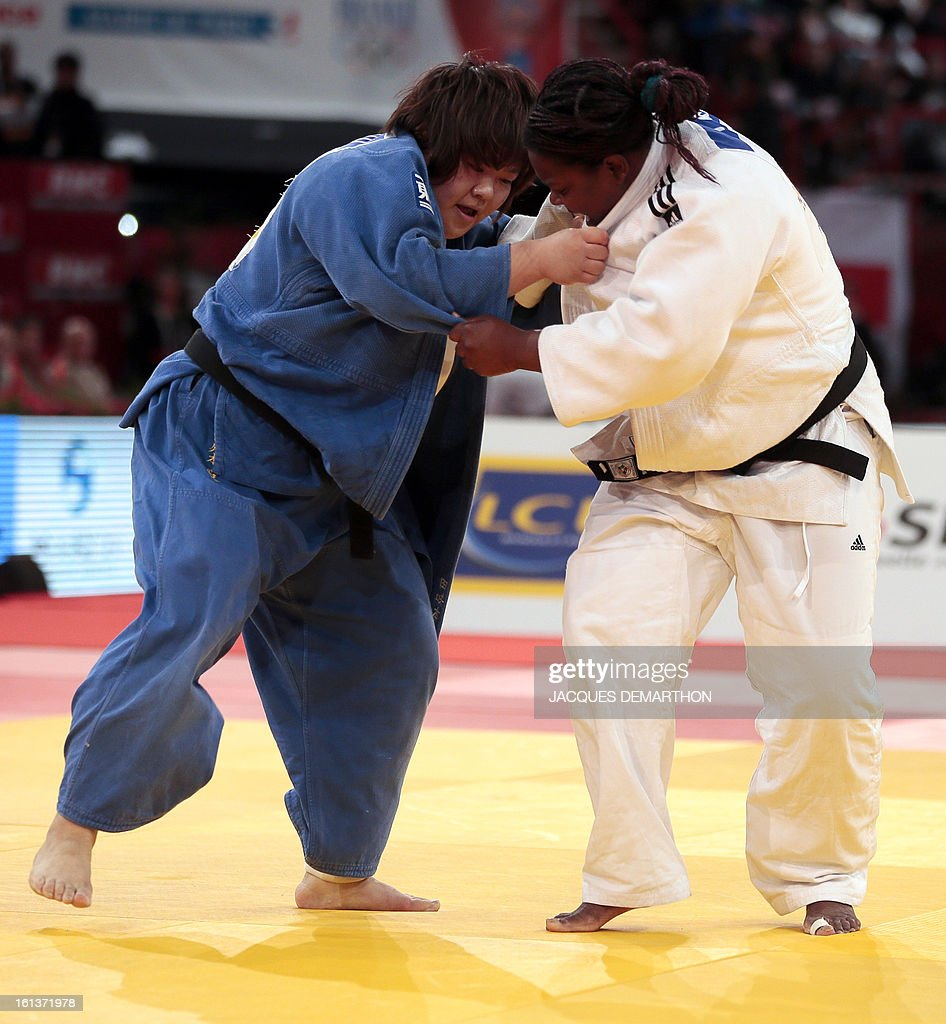 Japan's Tachimoto Migumi (blue) competes with Cuba's Idalys Ortiz (white) during the Final of the Women +78kg category of the Paris Judo Grand Slam tournament at the Palais Omnisports de Paris-Bercy (POPB) in Paris, on February 10, 2013.